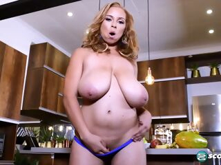 amateur Shara Lopez is playing with her massive milk jugs, while she is alone in the kitchen big tits blonde